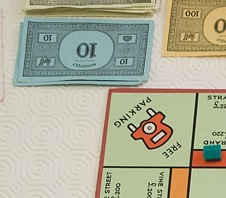 "House rule - A common Monopoly house rule is to put money from tax fines onto the ""Free Parking"" square, and agreeing that any player landing there can pick the money up."