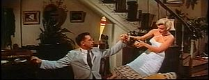 Monroe and Ewell open a bottle in The Seven Year Itch trailer 1.jpg