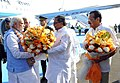 Narendra Modi being received by the Chief Minister of Karnataka, Shri Siddaramaiah on his arrival, at Bangalore airport on February 18, 2015. The Union Minister for Law & Justice, Shri D.V. Sadananda Gowda is also seen.jpg