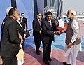 Narendra Modi being welcomed by the Union Minister for Electronics & Information Technology and Law & Justice, Shri Ravi Shankar Prasad, on his arrival, at the 5th Global Conference on Cyber Space (GCCS2017), at Aerocity.jpg