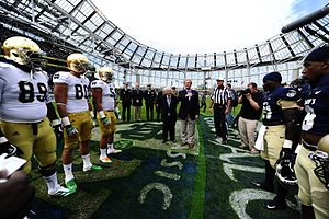 Emerald Isle Classic - US Ambassador Dan Rooney and Taoiseach Enda Kenny take part in the ceremonial coin toss before the 2012 game at Aviva Stadium