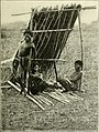 "Negrito people in a lean-to shelter. Image from page 94 of ""The Philippine Islands"" (1899).jpg"