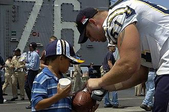 Nick Hardwick (American football) - Hardwick signing an autograph.
