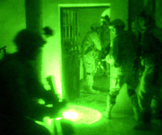 Night combat - Paratroopers in Fallujah, Iraq conduct a night raid using night vision goggles.