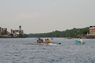 Passaic River - Oarswomen from Nutley High School and their coach working out in the Passaic River at Newark
