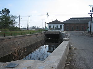 Carondelet Canal - This drainage canal, in use in the early 21st century, in back of a Broad Street pumping station near St. Louis Street, is a surviving remnant of the old Carondelet Canal.
