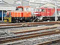 Omiya G-R-S-C Railway motor car HTM270 OM-2 & EH500-68 of JR Freight during replacement activity.jpg