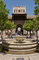 Orange trees courtyard fountain cathedral Puerta del Perdon Seville Spain.jpg