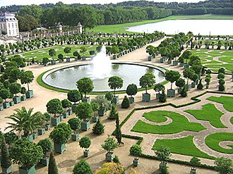 Gardens of Versailles - The Orangerie in the gardens of the Palace of Versailles with the Pièce d'Eau des Suisses in the background
