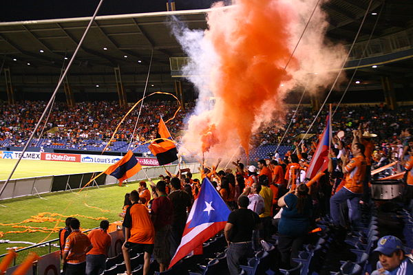Puerto Rico Islanders fans at a soccer game Orangestarsultra.jpg