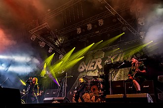 "Overkill (band) - Overkill at San Metal Open Air 2017. From left to right: Bobby ""Blitz"" Ellsworth, Derek Tailer, D. D. Verni, Jason Bittner and Dave Linsk."