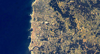 Geography of Póvoa de Varzim - Satellite image of Póvoa de Varzim. Cape Santo André is up north and Ave River in the south. The great dark spot in the middle is the Serra de Rates forest area.