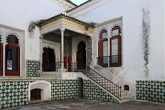 Palace of Sintra - Main courtyard with a Mudéjar-style mullioned windows and portal and 16th-century geometrical tile decoration.