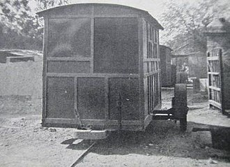 Patiala State Monorail Trainways - A closed passenger coach showing the single rail and the diameter 36 inch iron balance wheel