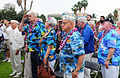 Pearl Harbor survivors and members of the Greatest Generation Foundation, render a salute as the colors are posted, during the Pearl Harbor Memorial Parade at Fort Derussy Park, Honolulu 121207-A-TR316-016.jpg