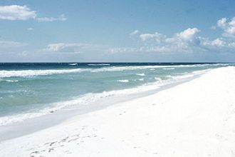 Gulf Islands National Seashore - The color of the sand in the region is exceptionally white, as seen in this 1957 photo at Pensacola Beach, Florida, adjacent to the protected area designated in 1971.