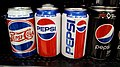 Pepsi cans with diferent logos.jpg
