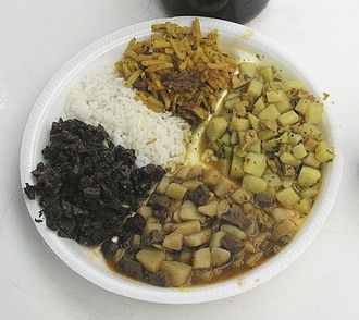 Ch'arki - Peruvian combo plate: from lower left, clockwise: Sangrecita (blood stew), rice, olluquito with charqui, Cau-cau (rumen stew), and chanfainita (diced beef lung stew with potatoes)