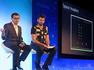 Demis Hassabis - Demis Hassabis (left) with Blaise Agüera y Arcas (right) in 2014, at the Wired conference in London