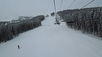 Breckenridge Ski Resort - The Independence SuperChair services moderate intermediate terrain on the lower part of Peak 7