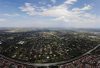 Plantation, Florida - East-facing aerial photo of Plantation. Flamingo Road (bottom) separates Plantation from Sunrise.