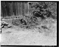 Plow at rear of house, north fence in background; view to northwest; 135mm lens. - Warner Hutton House, 13495 Sousa Lane, Saratoga, Santa Clara County, CA HABS CAL,43-SARA,6-14.tif