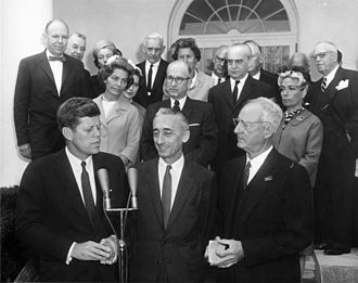 Melville Bell Grosvenor - Melville Grosvenor looks on as President Kennedy awards a NGS Gold Medal to Jacques Cousteau, who received one of his first grants from the Society.
