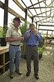 President George Bush, right, receiving briefing from Ralph Waycott, volunteer coordinator for the Rancho Sierra Vista Nursery, during Presidential visit to the Santa Monica Mountai - DPLA - 6cd56c89bdd110ebdc0060b51269bd34.jpg