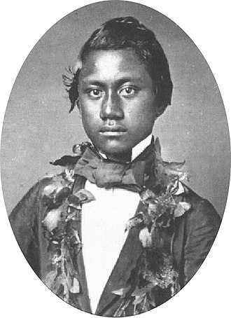 Kamehameha IV - Prince Alexander Liholiho wearing leis.