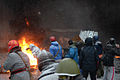Protesters throwing tires to the fire set by the protesters to prevent internal forces from crossing the barricade line. Kyiv, Ukraine. Jan 22, 2014-4.jpg