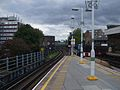 Putney Bridge stn through westbound platform look westbound.JPG