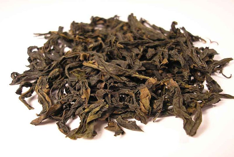 Loose dried Qi Lan Oolong tea leaves.