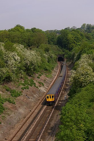Merstham tunnels - The south portal of Quarry Tunnel in 2008 with a class 319 passing through.