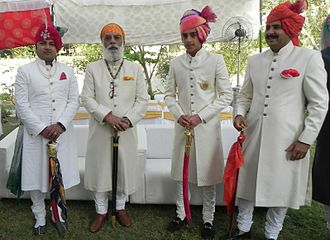 Sherwani - Achkan sherwani and churidar(lower body) worn by Maharaja Arvind Singh Mewar and his kin during a wedding in Rajasthan, India.