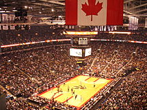 A packed ACC in a game against the Milwaukee Bucks on 3 November 2006. Toronto used an old alternate logo from many years before for the 2006–07 season, seen here in the centre of the court.