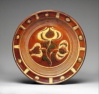 Redware - American redware slip-decorated dish, around 1800