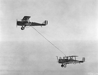 Capt. Lowell H. Smith and Lt. John P. Richter receiving the first mid-air refueling on June 27, 1923, from a plane flown by 1st Lt. Virgil Hine and 1st Lt. Frank W. Seifert. (Wikipedia)