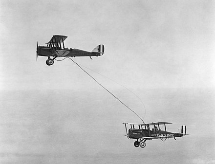 Capt. Lowell H. Smith and Lt. John P. Richter receiving the first mid-air refueling on June 27, 1923, from a plane flown by 1st Lt. Virgil Hine and 1st Lt. Frank W. Seifert. - Aerial refueling