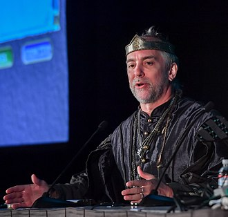 "Richard Garriott - Garriott, dressed as his ""Lord British"" persona, at the 2018 Game Developers Conference"