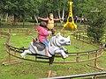 Riding a rhino (parc Saint-Paul).jpg