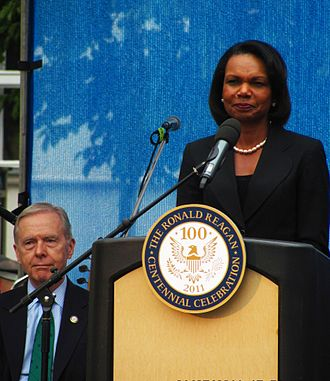 Pete Wilson - Wilson with Secretary of State Condoleezza Rice in downtown Prague as part of the Ronald Reagan Centennial Celebration, 2011