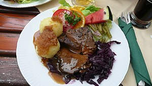 German cuisine - German Sauerbraten with potato dumplings (Klöße)