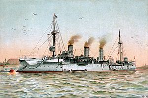 A white warship at anchor in calm seas, with smoke rising slowly from three smokestacks