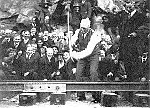 "San Diego and Arizona Railway - J.D. Spreckels drives the ""golden spike"" to ceremonially complete the San Diego and Arizona Railway on November 15, 1919."