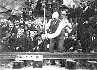 "1919 in rail transport - J.D. Spreckels drives the ""golden spike"" on the San Diego & Arizona Railway"