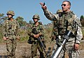 SGT Steven Tessitore shows JGSDF soldiers how U.S. Army sights in mortars, October 2006.jpg