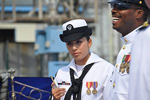 Boatswain's call - A boatswain's pipe being held by a sailor.