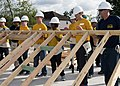 Sailors lift a structural wall during a Habitat for Humanity build for Houston Navy Week. (30411106696).jpg