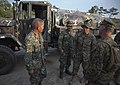 Sharing water before Balikatan 2014 140501-M-PU373-014.jpg
