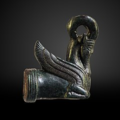 sharpener handle in the shape of the front of a winged, androcephalous mouflon